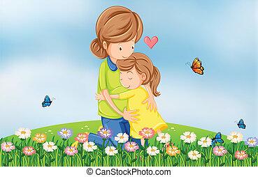 Una colina con una madre consolando a su hijo