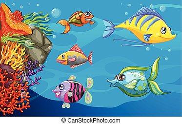 Una escuela de peces bajo el mar