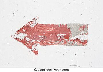 Una flecha roja en el fondo de la pared blanca