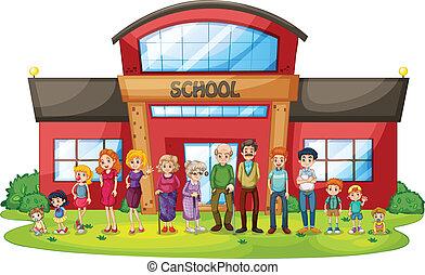 Una gran familia frente al edificio de la escuela