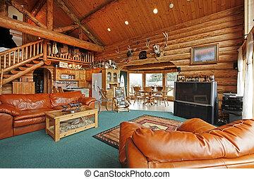 Una gran sala de estar de la cabaña con estilo vaquero