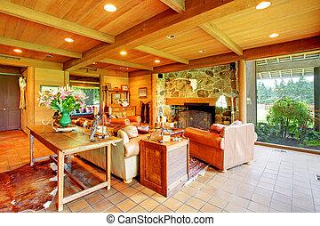 Una gran sala de estar en el rancho con la cocina.