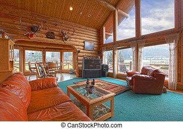 Una gran sala de estar en la cabaña rústica