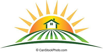Una granja con logotipo solar