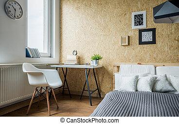 Una habitación moderna y cómoda