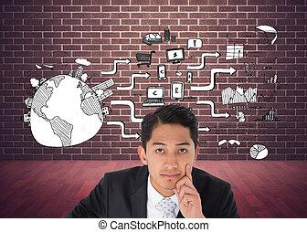 Una imagen compuesta de considerado empresario asiático apuntando