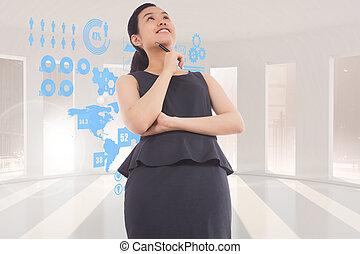 Una imagen compuesta de una mujer de negocios asiática