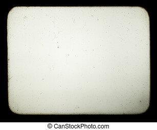 Una instantánea de una pantalla en blanco del viejo proyector de diapositivos, apropiada para lograr el efecto de las viejas fotos.