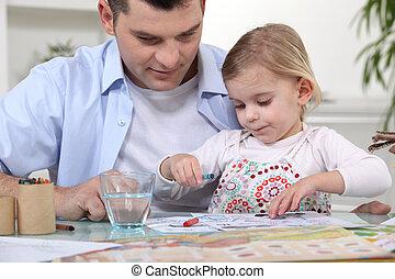 Una joven coloreando con papá