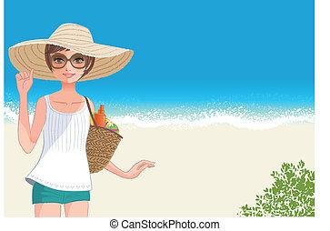 Una joven linda con sombrero de paja sonriente en la playa