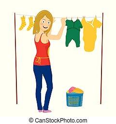 Una joven mujer feliz colgando ropa sucia aislada en blanco