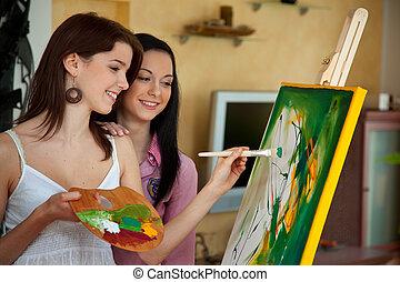 Una joven pintando en un caballete