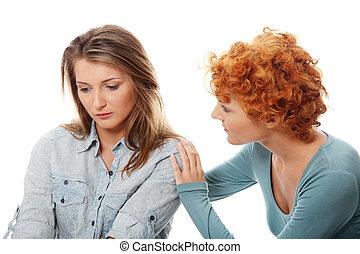 Una joven problemática confortada por su amiga