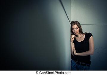 Una joven que sufre de una depresión severa
