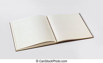 Una libreta en blanco aislada en gris
