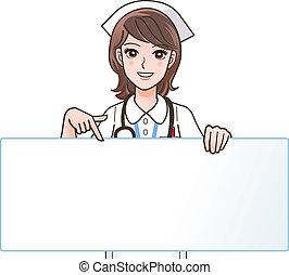 Una linda enfermera sonriente señalando a una