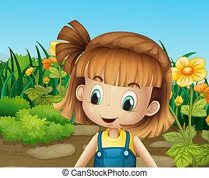 Una linda niña en el jardín con flores florecientes