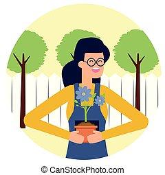 Una mujer jardinera con flores en jardinería