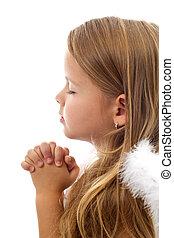 Una niña adorable rezando