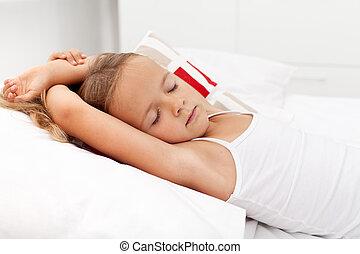 Una niña durmiendo
