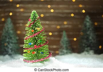 Una pacífica escena de invierno con árbol de Navidad