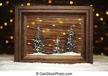 Una pacífica escena de invierno enmarcada con árboles y nieve