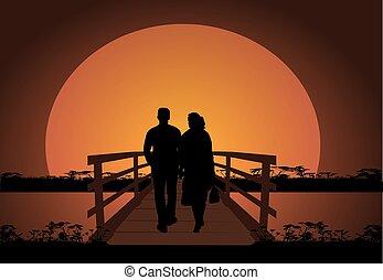 Una pareja ambulante por la noche.