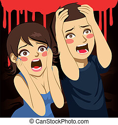 Una pareja asustada gritando