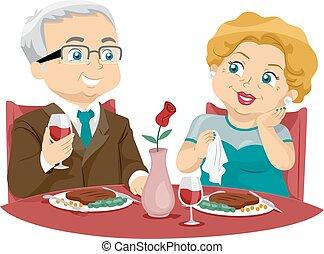 Una pareja de ancianos cenando bien