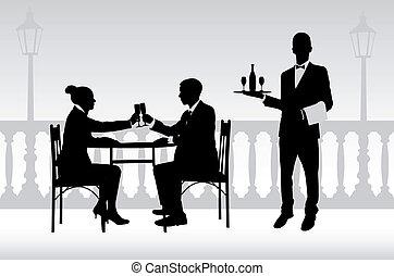 Una pareja en el restaurante y el camarero