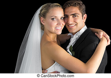 Una pareja joven atractiva abrazándose