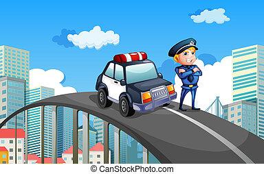 Una patrulla y un policía en medio de la autopista