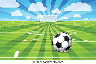 Una pelota de fútbol sobre la hierba del campo de juego