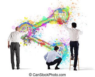 Una persona de negocios pinta icono en una pared. Aislado de fondo blanco