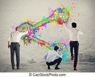 Una persona de negocios pinta icono en una pared