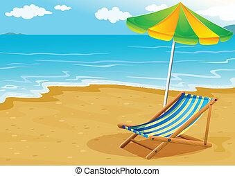 Una playa con un banco y un paraguas