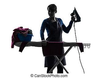 Una sirvienta que plancha la silueta