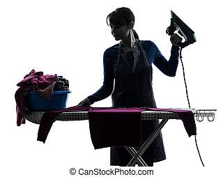 Una sirvienta que plancha silueta