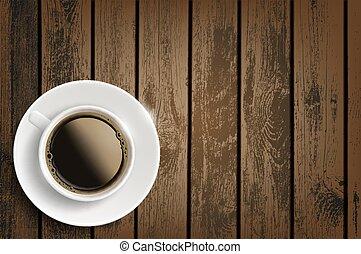 Una taza de café en una mesa de madera.