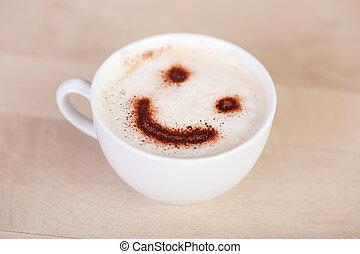 Una taza de capuchino con sonrisa