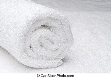 Una toalla blanca de spa
