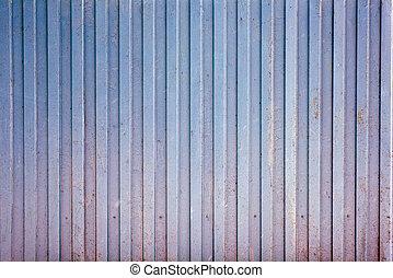 Una valla metálica aislada de color azul de la sábana corrugado