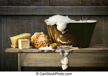 Una vieja bañera con jabón en el banco