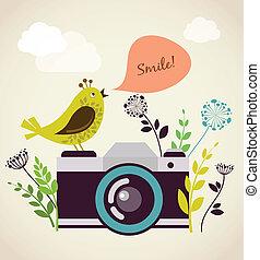 Una vieja cámara con pájaro