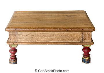 Una vieja mesa artesanal hecha de madera gastada