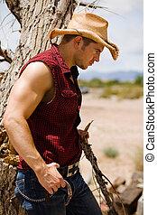 Vaquero junto al árbol