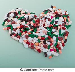 Varias pastillas en forma de corazón