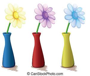 Vasos de colores con flores