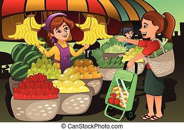 Vendedor de frutas en el mercado de agricultores con un cliente