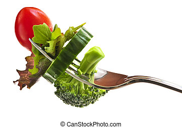 Verduras frescas en un tenedor